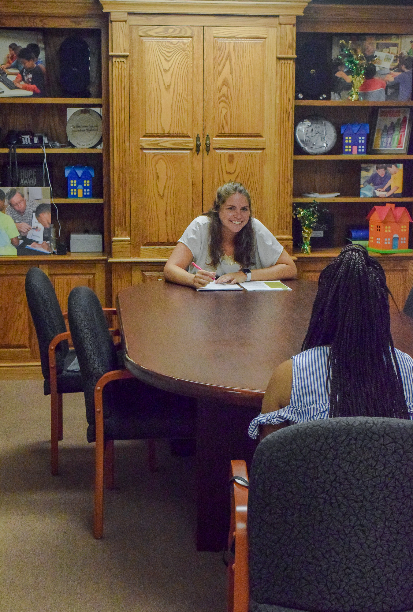 Young women conducting a mock interview workforce lab with student