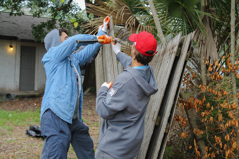 volunteers working on fence