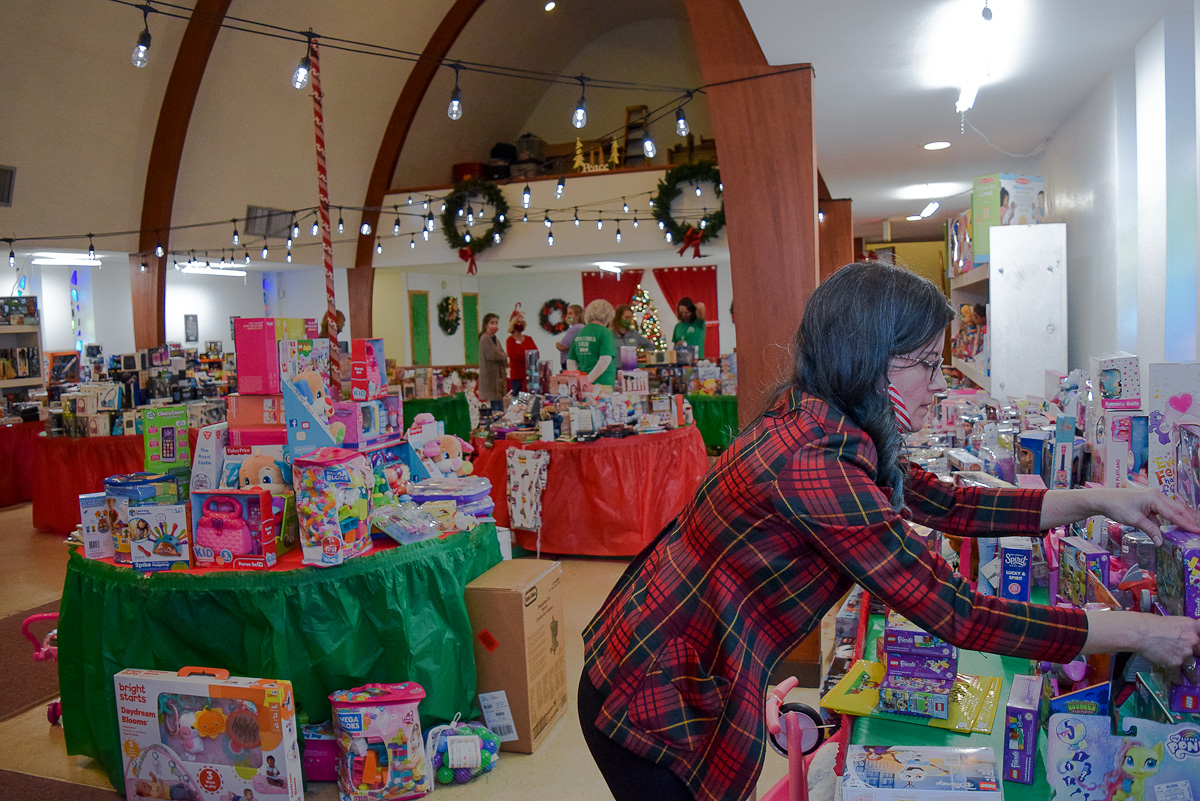 Christy Mitchell setting up the Christmas store